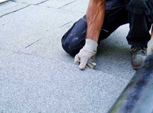 How to Install Roll Roofing on a Flat Roof